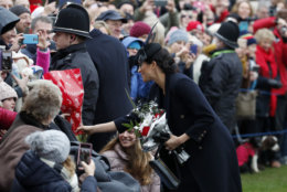 Britain's Meghan, Duchess of Sussex meets members of the crowd after attending the Christmas day service at St Mary Magdalene Church in Sandringham in Norfolk, England, Tuesday, Dec. 25, 2018. (AP Photo/Frank Augstein)