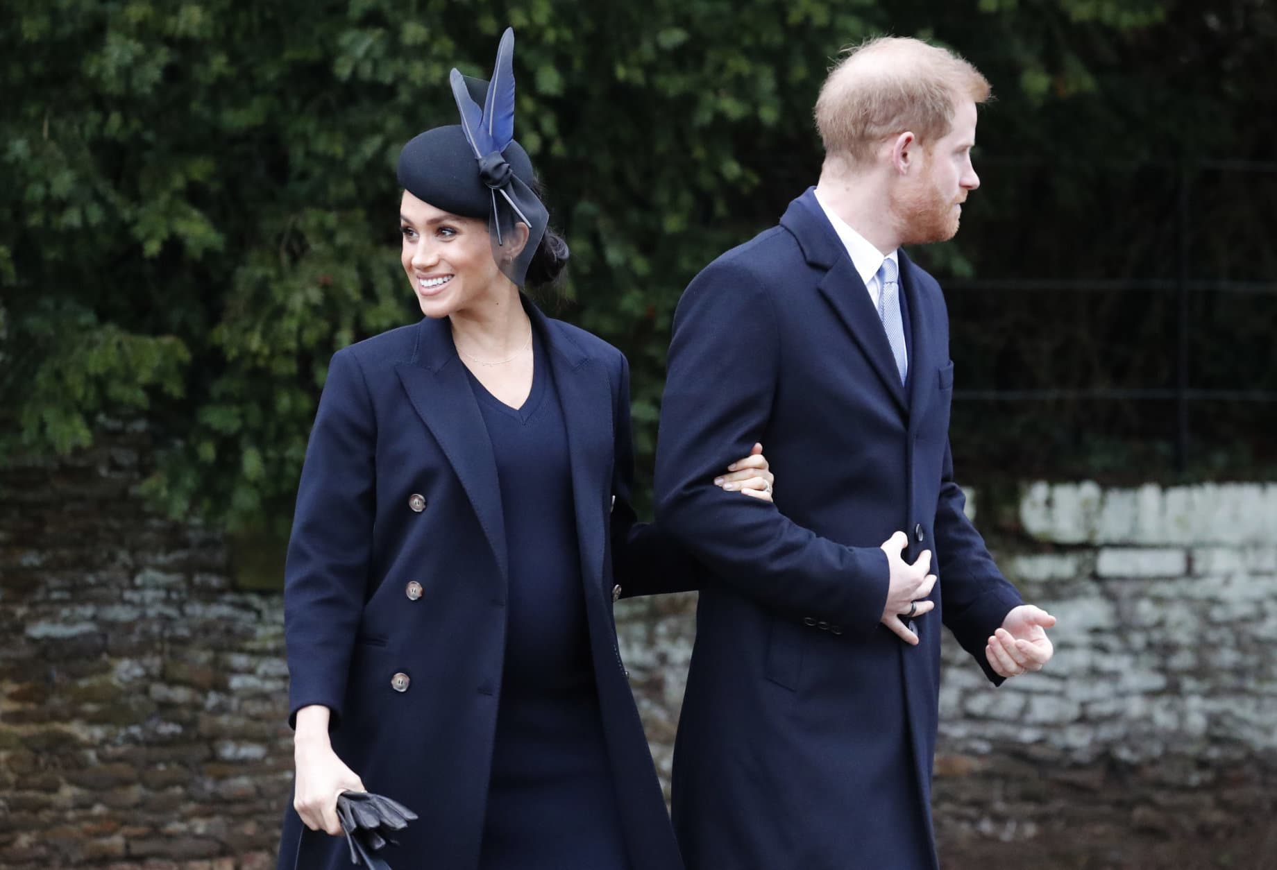 Britain's Prince Harry and Meghan, Duchess of Sussex leave after attending the Christmas day service at St Mary Magdalene Church in Sandringham in Norfolk, England, Tuesday, Dec. 25, 2018. (AP Photo/Frank Augstein)