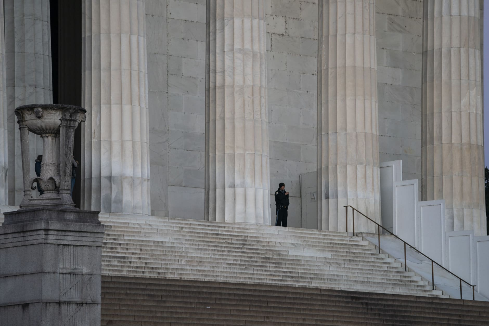 "A lone U.S. Park Police officer stands watch at the Lincoln Memorial, Thursday, Dec. 27, 2018, in Washington, during a partial government shutdown. There is no end in sight to the partial government shutdown. President Donald Trump has vowed to hold the line on his budget demand, telling reporters during his visit to Iraq Wednesday that he'll do ""whatever it takes"" to get money for border security. The White House and congressional Democrats have been talking but to little effect. Washington area national parks will remain open during the partial government shutdown, but without visitor center services. (AP Photo/J. Scott Applewhite)"