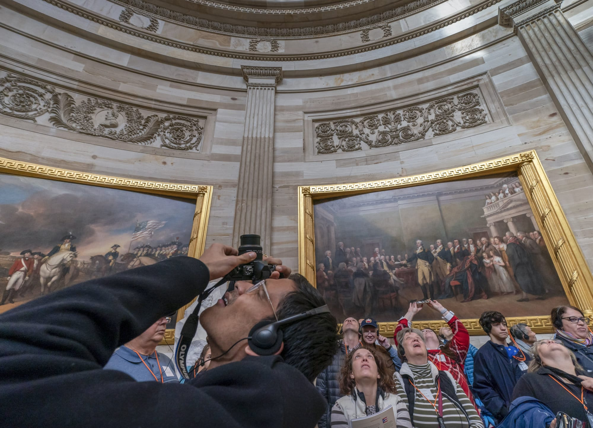 Visitors tour the Capitol Rotunda at the Capitol in Washington, Thursday, Dec. 27, 2018, during a partial government shutdown. Chances look slim for ending the partial government shutdown any time soon. Lawmakers are away from Washington for the holidays and have been told they will get 24 hours' notice before having to return for a vote. (AP Photo/J. Scott Applewhite)