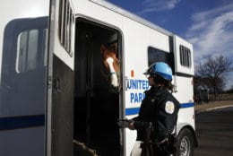 "Park Police Horse Mounted Patrol Unit Officer Baum, who is working without pay due to the government shutdown, puts Monty into a horse trailer at the end of their day, across from the Martin Luther King Jr. Memorial, Thursday, Dec. 27, 2018, in Washington, during a partial government shutdown. President Donald Trump has vowed to hold the line on his budget demand, telling reporters during his visit to Iraq Wednesday that he'll do ""whatever it takes"" to get money for border security. The White House and congressional Democrats have been talking but to little effect. Washington area national parks will remain open during the partial government shutdown, but without visitor center services. (AP Photo/Jacquelyn Martin)"