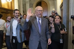 With reporters seeking comment, Republican Senator Pat Roberts of Kansas, chairman of the Senate Agriculture Committee, departs after he opened and closed a brief session of the U.S. Senate amid the partial government shutdown, at the Capitol in Washington, Thursday, Dec. 27, 2018. (AP Photo/J. Scott Applewhite)