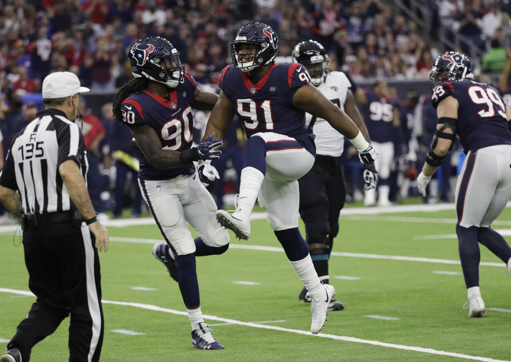 Houston Texans outside linebacker Jadeveon Clowney (90) and defensive end Carlos Watkins (91) celebrate after sacking Jacksonville Jaguars quarterback Blake Bortles during the second half of an NFL football game, Sunday, Dec. 30, 2018, in Houston. (AP Photo/David J. Phillip)