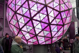 Workers in New York's Times Square perform a test on Sunday, Dec. 30, 2018, of the New Year's Eve ball that will be lit and sent up a 130-foot pole atop One Times Square to mark the start of the 2019 new year. Organizers of the annual event say the ball, illuminated by LEDs and enhanced by Waterford Crystal triangles, is capable of displaying a palette of more than 16 million vibrant colors and billions of patterns to create a spectacular kaleidoscope effect. (AP Photo/Julie Walker)