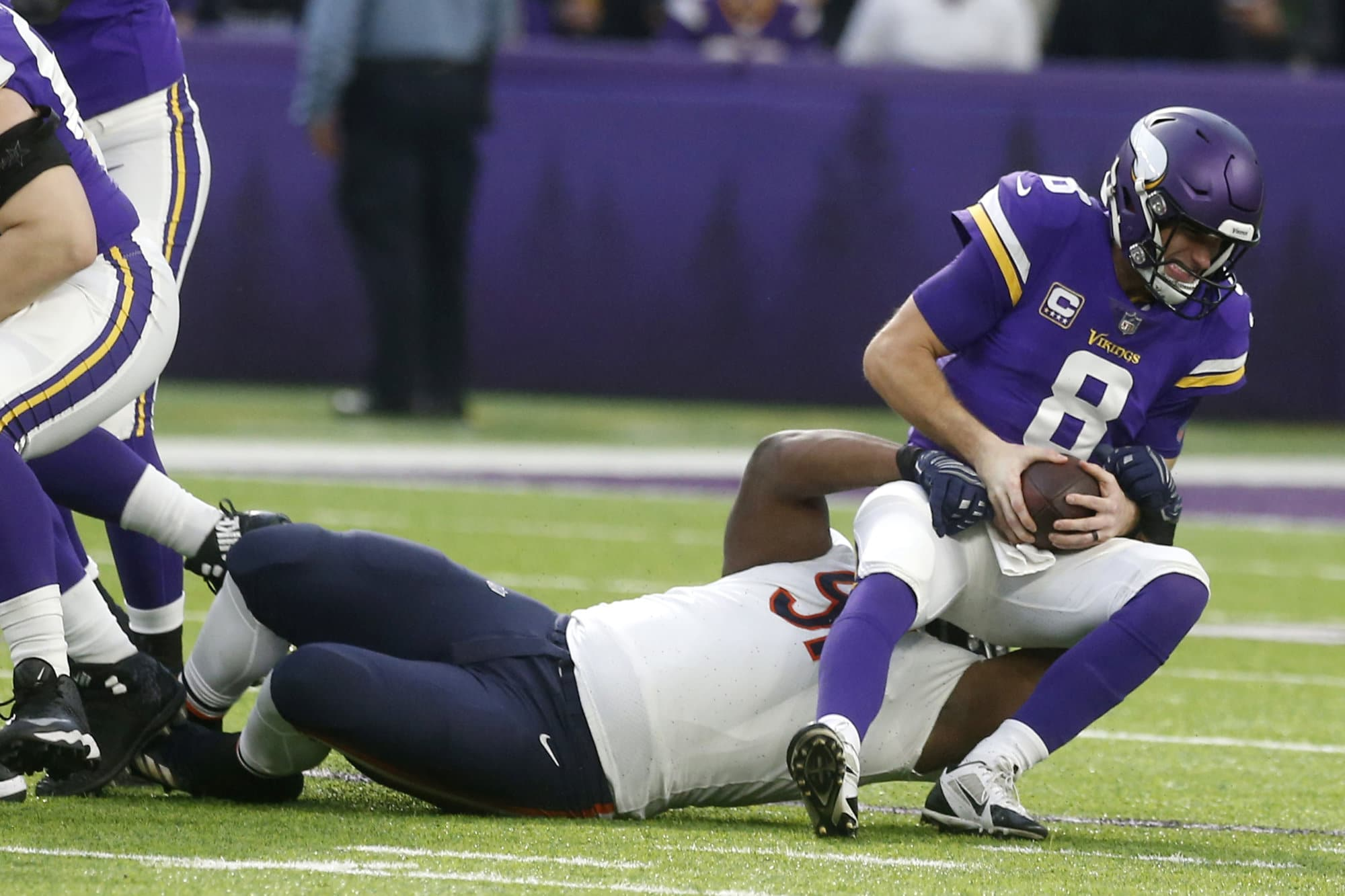 Minnesota Vikings quarterback Kirk Cousins (8) is sacked by Chicago Bears nose tackle Eddie Goldman during the first half of an NFL football game, Sunday, Dec. 30, 2018, in Minneapolis. (AP Photo/Jim Mone)