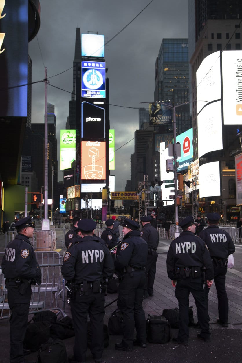 Police assemble in New York's Times Square before patrolling on New Year's Eve, Monday, Dec. 31, 2018. (AP Photo/Mark Lennihan)