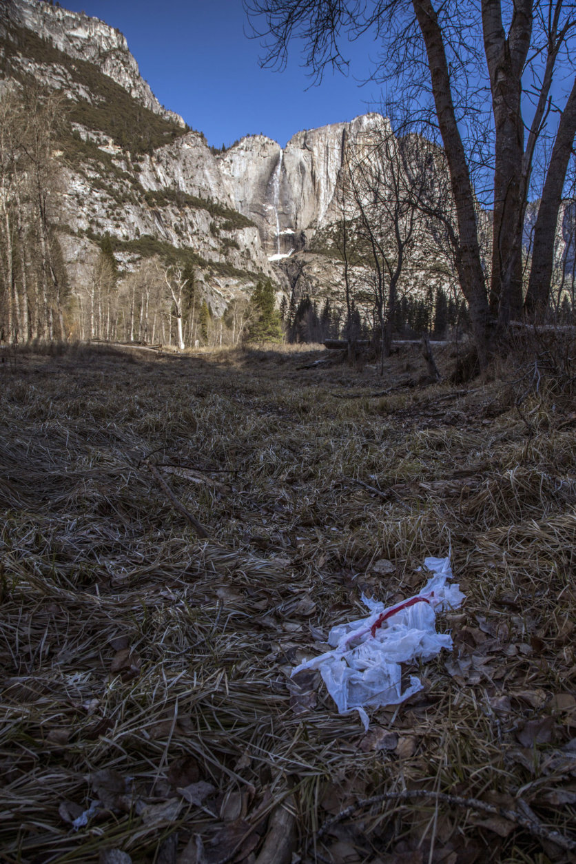 In this Monday, Dec. 31, 2018 photo provided by Dakota Snider shows trash tossed on the grounds in Yosemite National Park, Calif. Human feces, overflowing garbage, illegal off-roading and other damaging behavior in fragile areas were beginning to overwhelm some of the West's iconic national parks on Monday, as a partial government shutdown left the areas open to visitors but with little staff on duty. (Dakota Snider via AP)