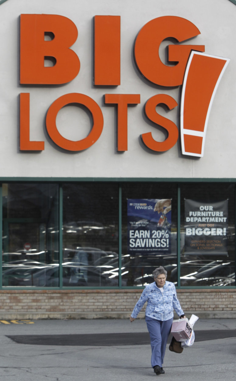 A shopper leaves the Big Lots storeon Tuesday, Dec. 4, 2012 in Berlin, Vt. Big Lots reported a loss for its fiscal third quarter, weighed down by higher expenses and lower U.S. sales. But the discount retailer beat Wall Street's view and raised its full-year forecast, citing expectations for the fourth quarter. (AP Photo/Toby Talbot)