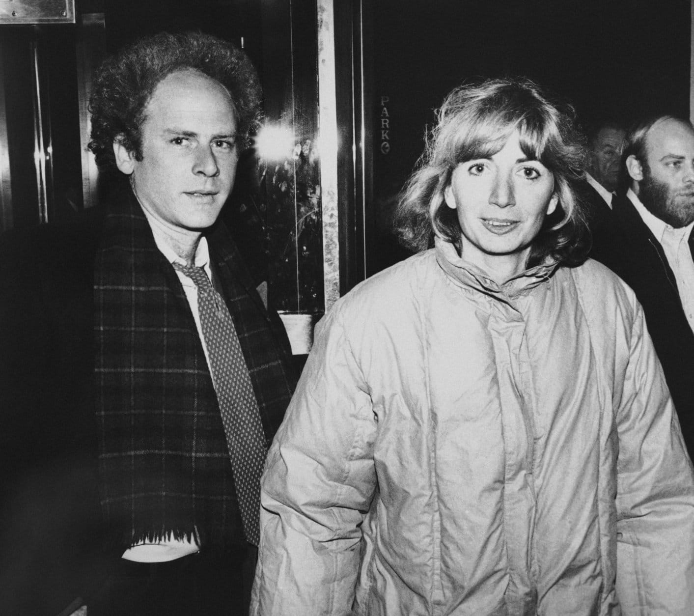 "Actress Penny Marshall and singer-composer-actor Art Garfunkel arrive at the Uris Theater in New York City, Feb. 17, 1981. They were arriving to attend a performance of the revival of Gilbert and Sullivan's ""Pirates of Penzance."" (AP Photo/Steve Sands)"