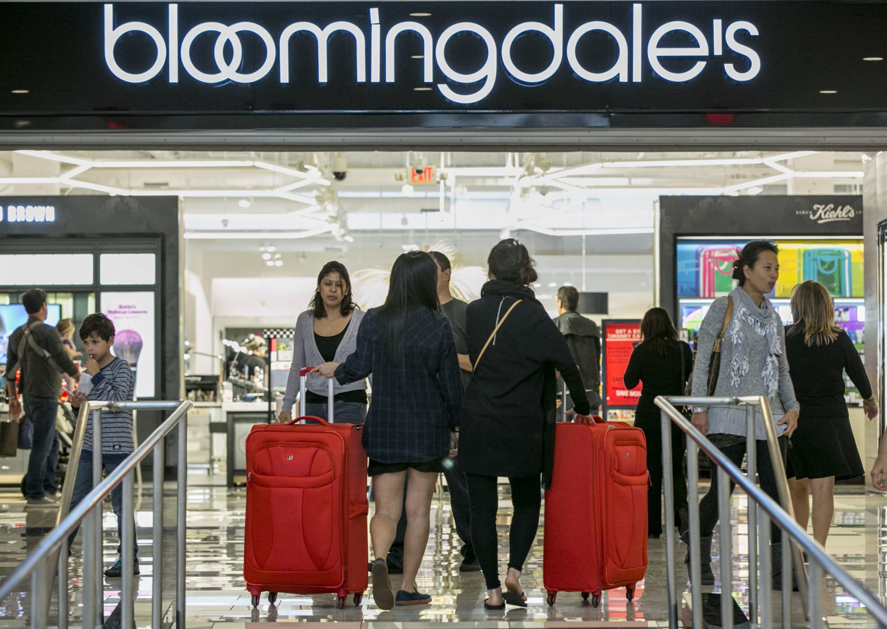 Consumers shop at the Bloomingdale's store at the Glendale Galleria shopping mall in Glendale, Calif, Friday, Nov. 28, 2014. Stores are welcoming a second wave of consumers in what has become a two-day kickoff to the holiday shopping season. The National Retail Federation forecasts holiday sales will grow 4.1 percent to $616.9 billion, the biggest jump since 2011. (AP Photo/Damian Dovarganes)