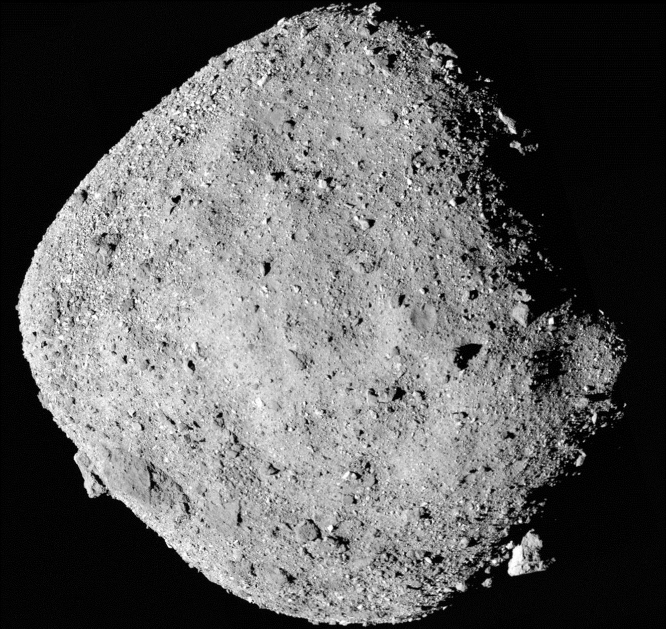 FILE - This file mosaic image composed of 12 PolyCam images collected on Dec. 2, 2018, and provided by NASA shows the asteroid Bennu. The Osiris-Rex spacecraft entered orbit Monday, Dec. 31, 2018, around the asteroid Bennu, 70 million miles (110 million kilometers) from Earth. It's the smallest celestial body ever to be orbited by a spacecraft. Bennu is just 1,600 feet (500 meters) across. (NASA/Goddard/University of Arizona via AP, File)