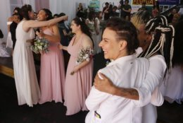 Gay couples greets each other after they get married in a group marriage of forty same sex couples in Sao Paulo, Brazil, Saturday, Dec. 15, 2018.  With the election of ultra-rightist Jair Bolsonaro as president, hundreds of same sex couples began to marry, fearing that the administration of Bolsonaro, who accumulates a history of homophobic and derogatory comments towards gays, could hinder the union of people of the same sex.  (AP Photo/Nelson Antoine)