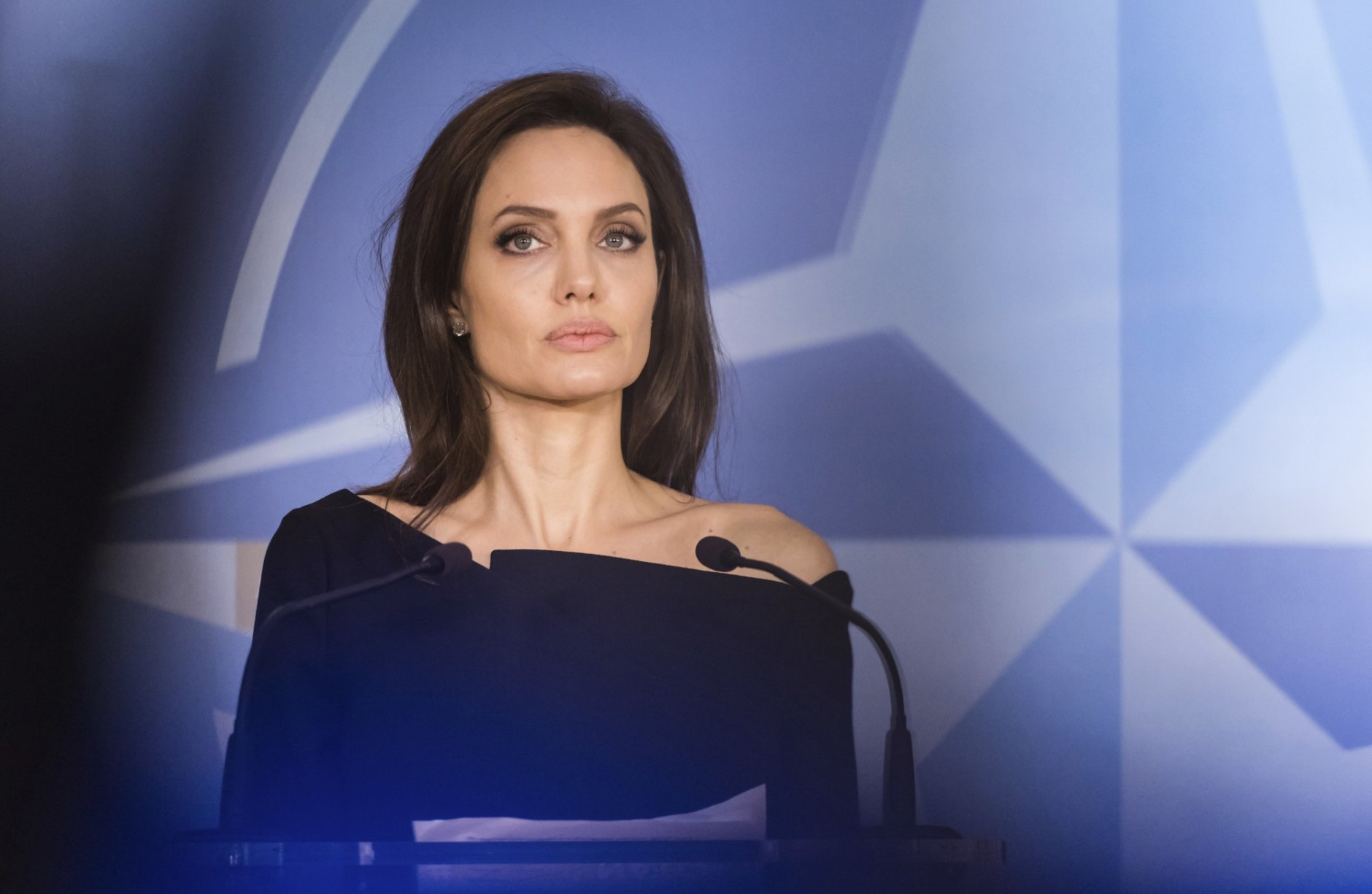 FILE - In this file photo dated Wednesday, Jan. 31, 2018, Special Envoy for the United Nations High Commissioner for Refugees Angelina Jolie addresses the media at NATO headquarters in Brussels.  American actress Jolie has not ruled out a move into politics, during an interview on BBC radio Friday Dec. 28, 2018, and has joked that she might be tough enough to take the rough and tumble that comes with it. (AP Photo/Geert Vanden Wijngaert, FILE)