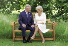 This photo released by Clarence House on Friday Dec. 14, 2018, shows the photo taken by Hugo Burnand of Britain's Prince Charles and Camilla, Duchess of Cornwall in the grounds of Clarence House, London, which is to be used as their 2018 Christmas card. (Hugo Burnand/Clarence House via AP)
