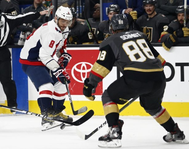 eee5fc10833 Washington Capitals left wing Alex Ovechkin (8) passes around Vegas Golden  Knights defenseman Nate Schmidt (88) during the first period of an NHL  hockey ...