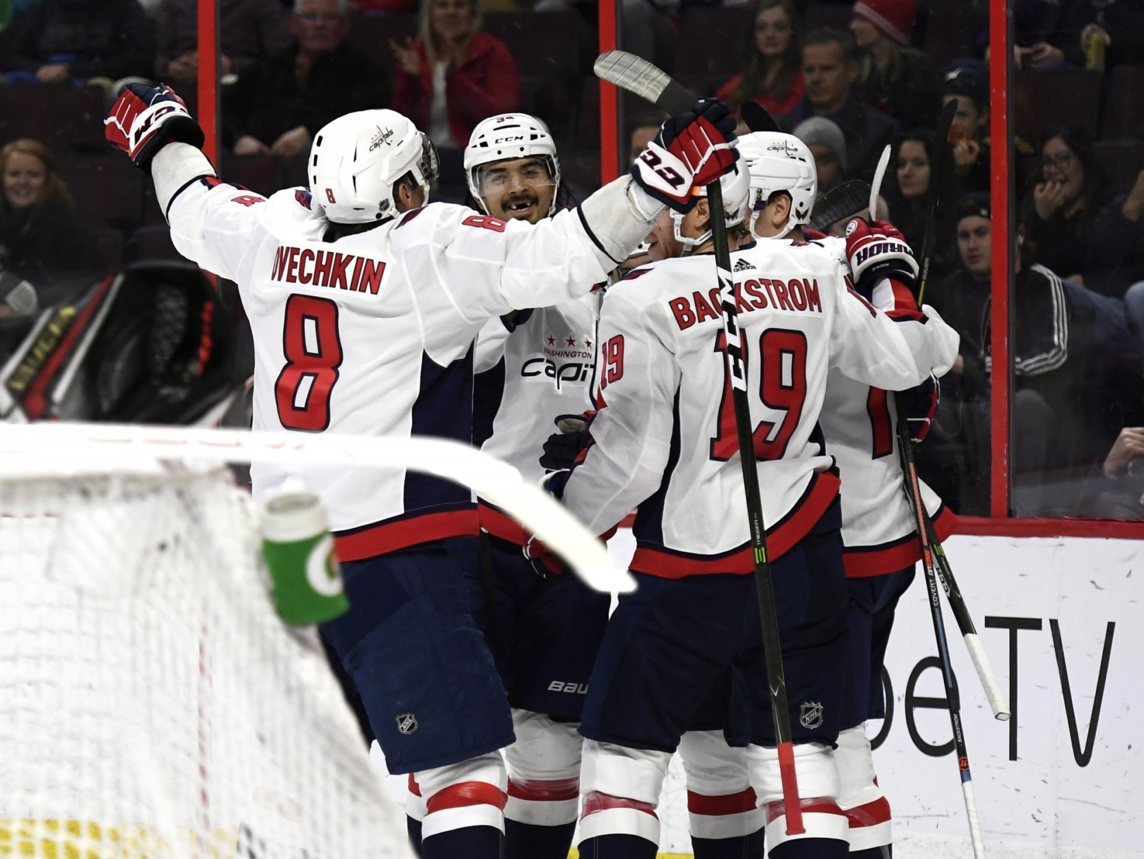 Washington Capitals players celebrate a goal against the Ottawa Senators during the first period of an NHL hockey game, Saturday, Dec. 29, 2018 in Ottawa, Ontario. (Justin Tang/The Canadian Press via AP)