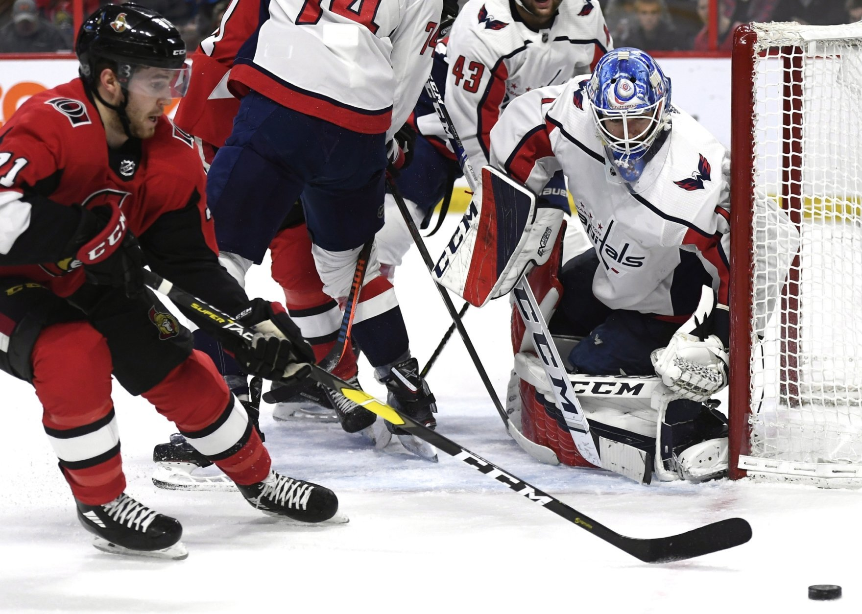 Washington Capitals goaltender Pheonix Copley (1) watches the puck as Ottawa Senators center Chris Tierney (71) tries to control it during the second period of an NHL hockey game, Saturday, Dec. 29, 2018 in Ottawa, Ontario. (Justin Tang/The Canadian Press via AP)