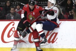 Ottawa Senators left wing Zack Smith (15) collides with Washington Capitals defenseman Tyler Lewington (78) during the second period of an NHL hockey game, Saturday, Dec. 29, 2018 in Ottawa, Ontario. (Justin Tang/The Canadian Press via AP)
