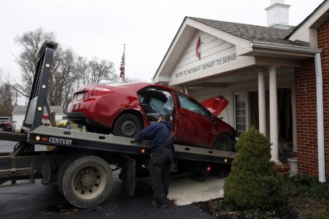 6 hurt when car crashes into church, shatters stained glass