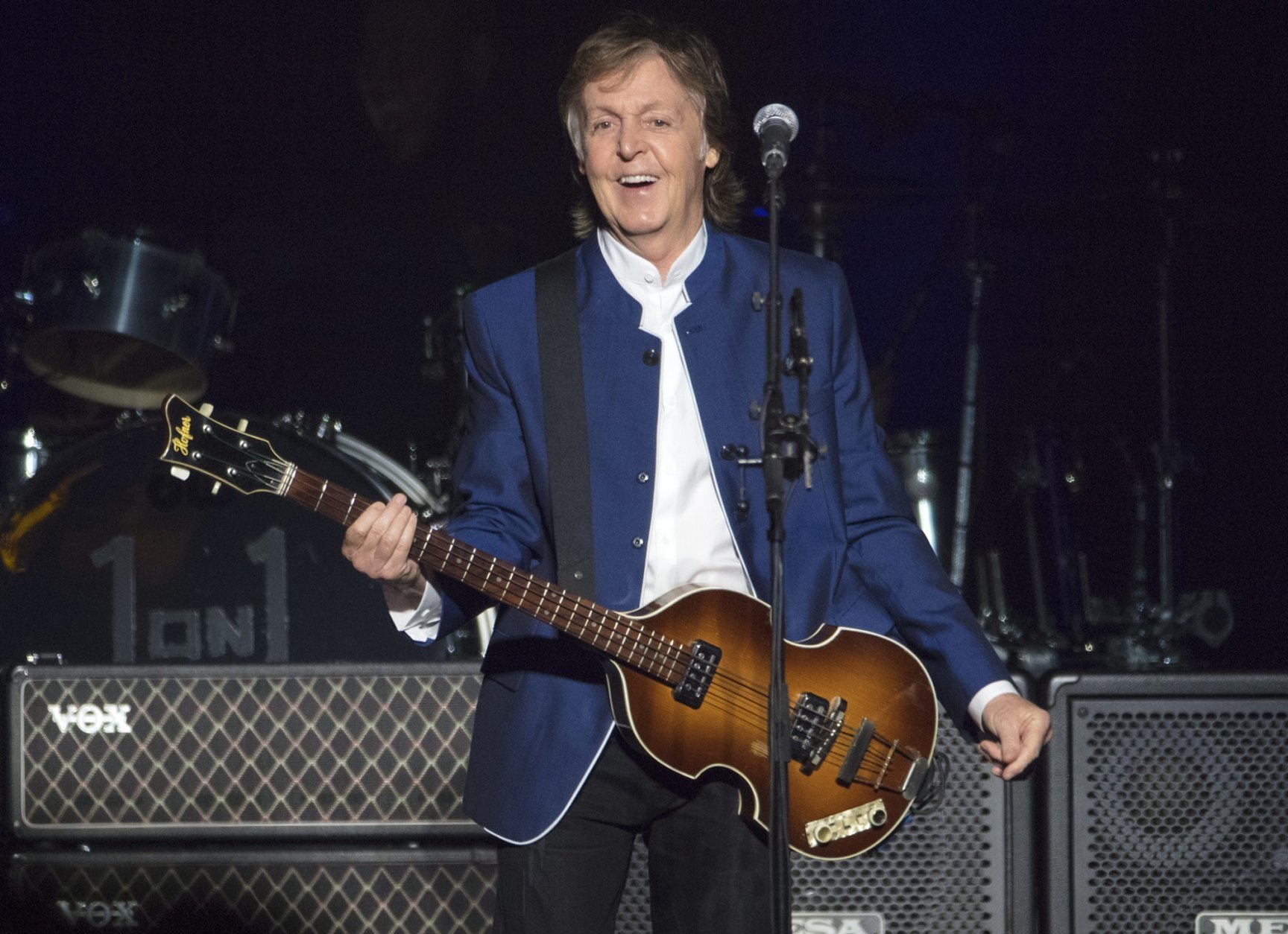 FILE - In this Monday, July 10, 2017 file photo, Sir Paul McCartney performs at Amalie Arena in Tampa, Fla. Most hosts would be quite happy to have Paul McCartney come to a shindig. Paul McCartney's Christmas message to his fans around the world: Don't be like me and eat and drink too much. The 76-year-old former Beatle tweeted his lighthearted holiday wishes Tuesday, Dec. 25, 2018 illustrated with photos from his younger days. (AP Photo/Scott Audette, file)