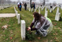 Some people lay wreaths while others look for family members at the Arlington National Cemetery. (WTOP/Kristi King)