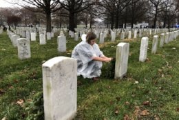 Volunteers braved the cold and rain to honor those who served. (WTOP/Kristi King)