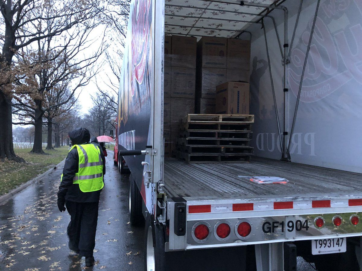 Trucks unloaded wreaths starting at about 9 a.m. (WTOP/Kristi King)