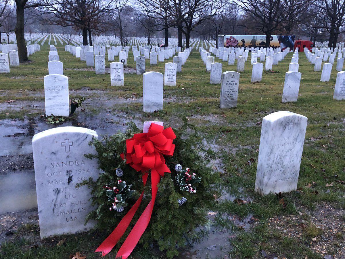 Volunteers laid wreaths across the Arlington National Cemetery. (WTOP/Kristi King)
