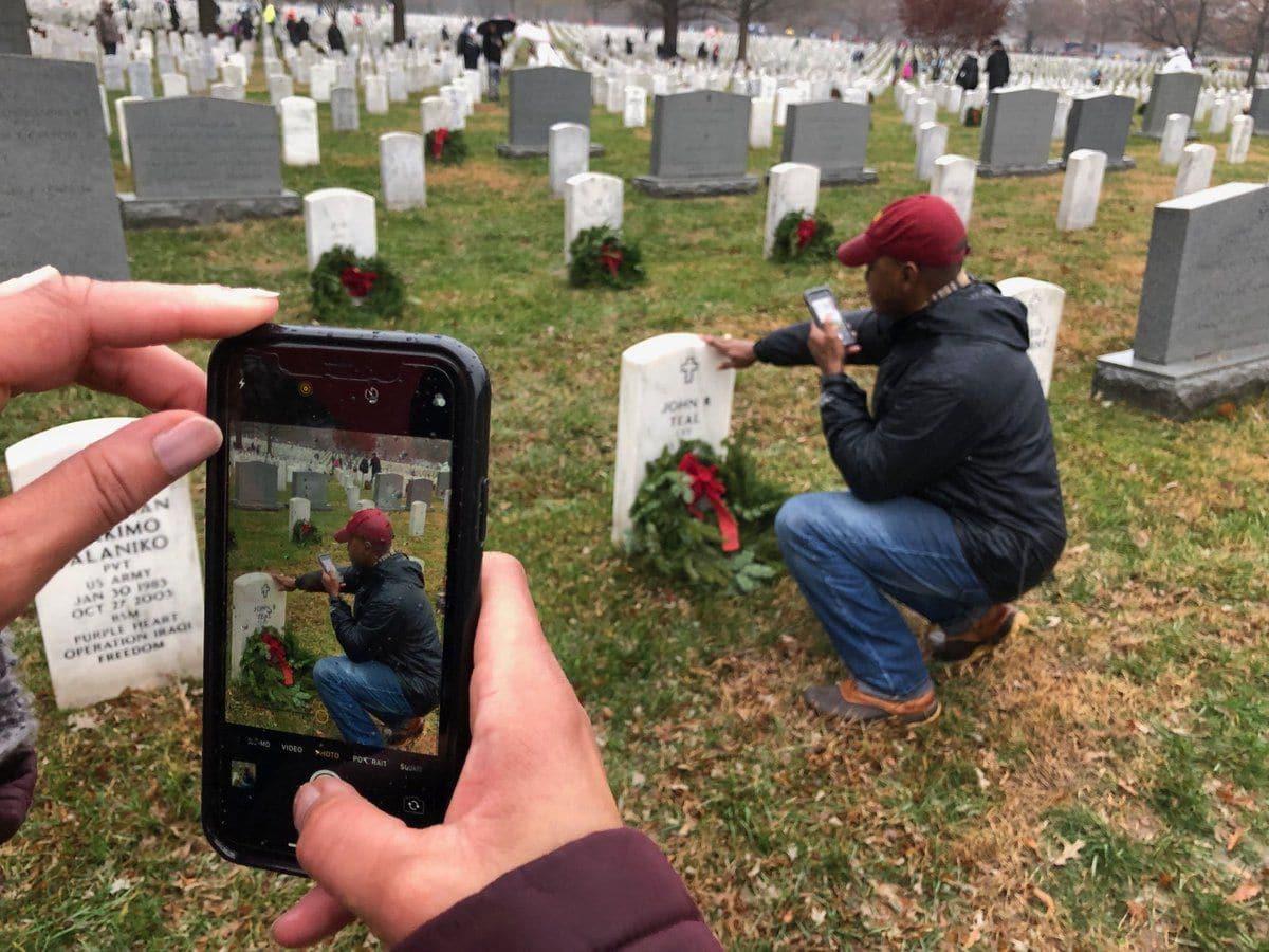 A volunteer honors a fallen classmate. (WTOP/Kristi King)