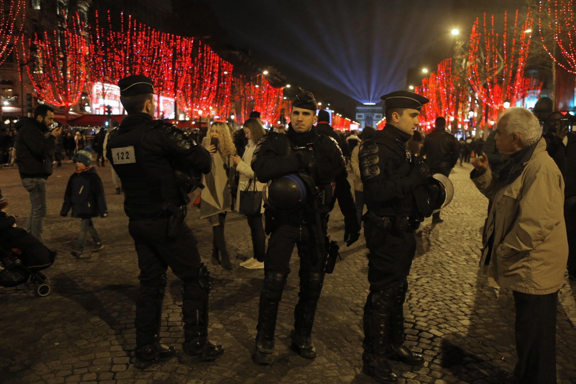 French policemen stand guard before the New Year's Day celebrations on the Champs Elysees, in Paris, Monday, Dec. 31, 2018. Paris is preparing to hold its annual New Year's Eve celebrations on the Champs-Elysees under heavy security as some yellow vest protesters are planning to march on the famed avenue. (AP Photo/Michel Euler)