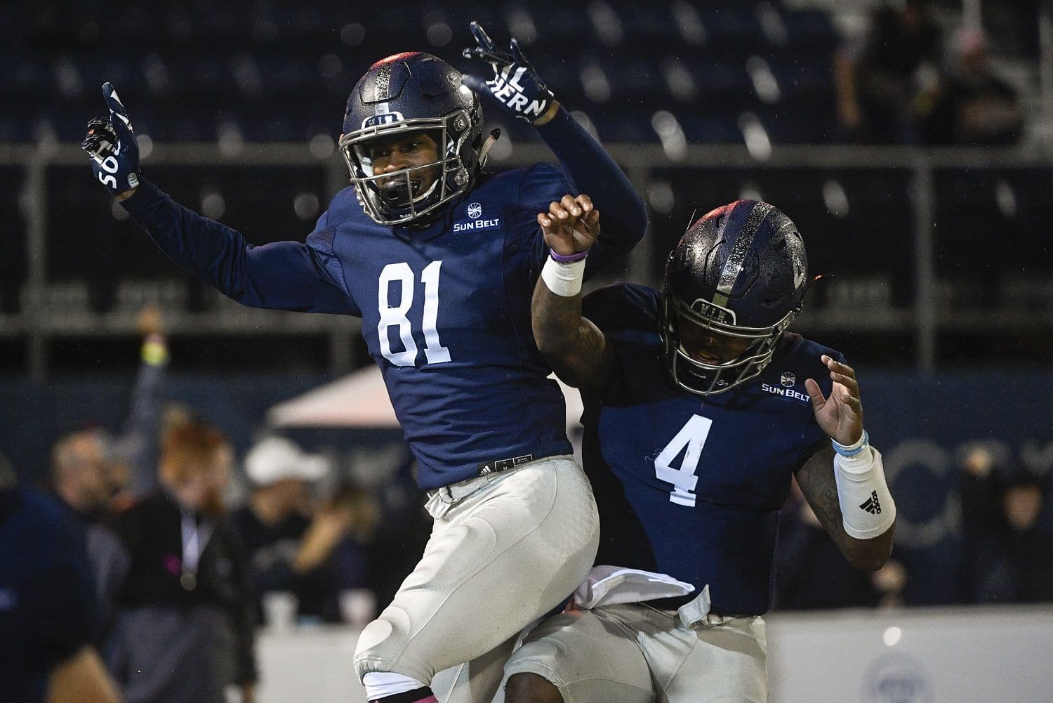 Georgia Southern wide receiver Darion Anderson (81) celebrates his touchdown with quarterback Shai Werts during the first half of an NCAA college football game against Appalachian State, Thursday, Oct. 25, 2018, in Statesboro, Ga. (AP Photo/John Amis)