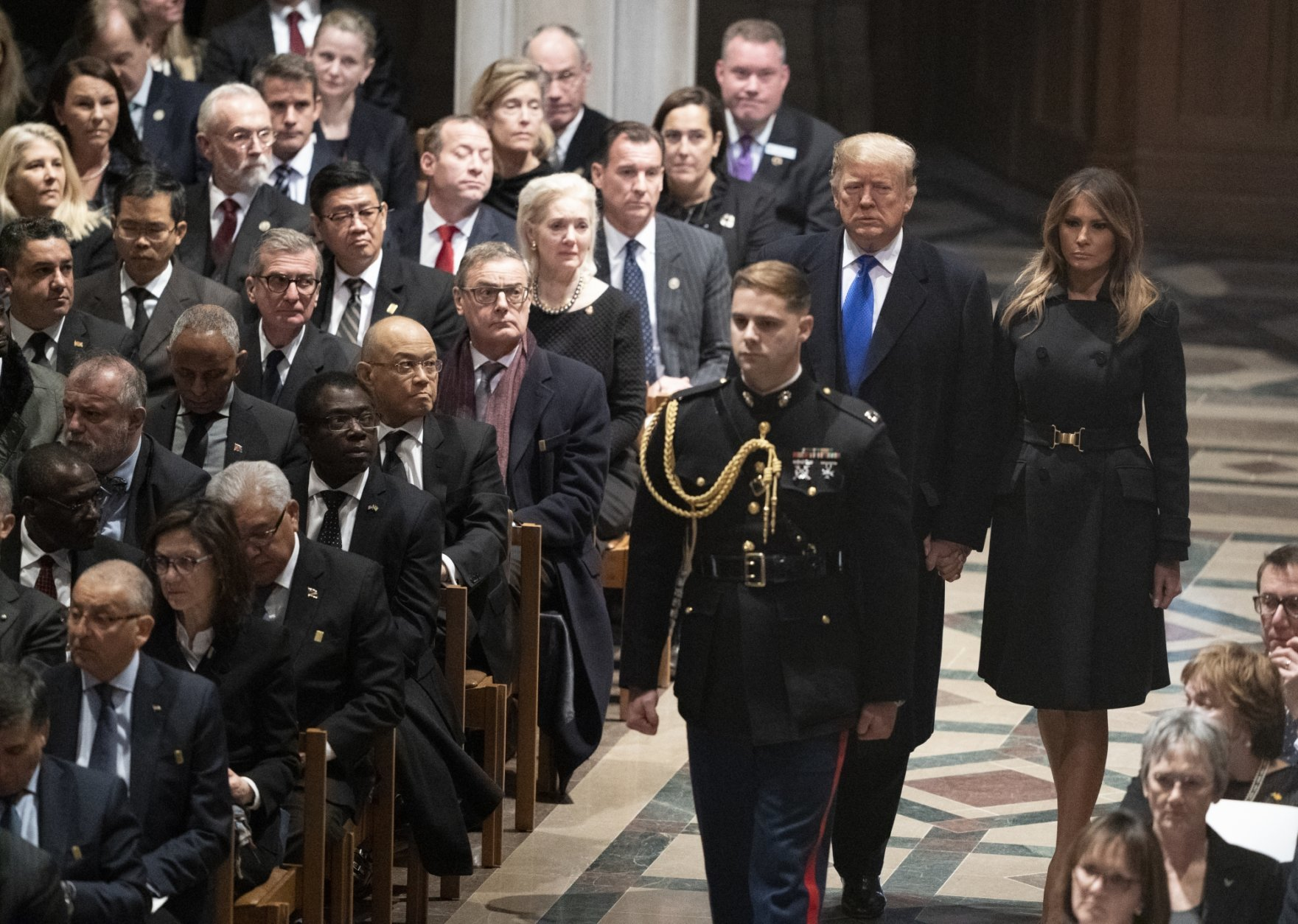 President Donald Trump and first lady Melania Trump arrive for the State Funeral for former President George H.W. Bush at the Washington National Cathedral in Washington, Wednesday, Dec. 5, 2018. (AP Photo/Carolyn Kaster)