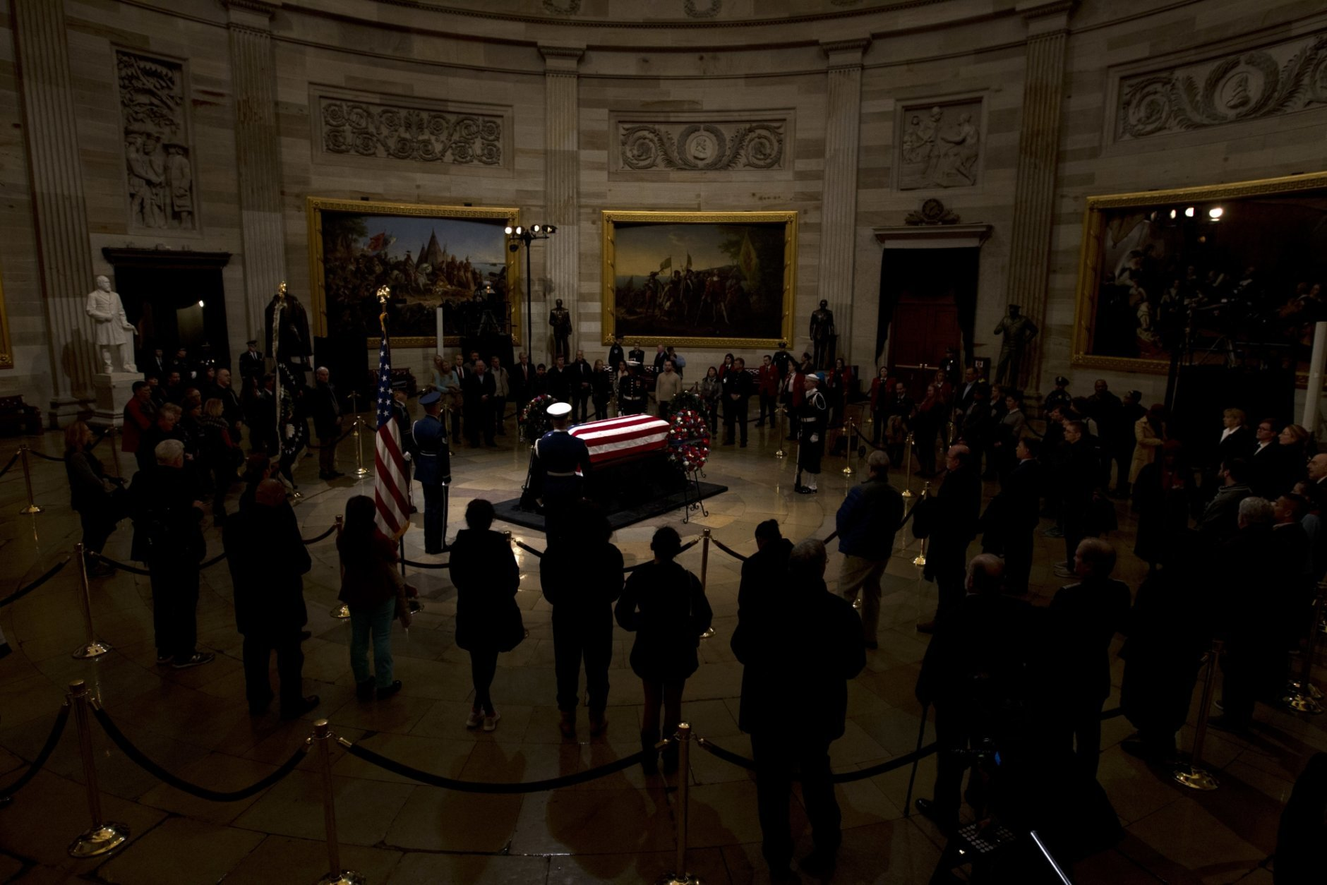 The flag-draped casket of former President George H.W. Bush lies in state in the Capitol Rotunda in Washington, Wednesday, Dec. 5, 2018. (AP Photo/Jose Luis Magana)