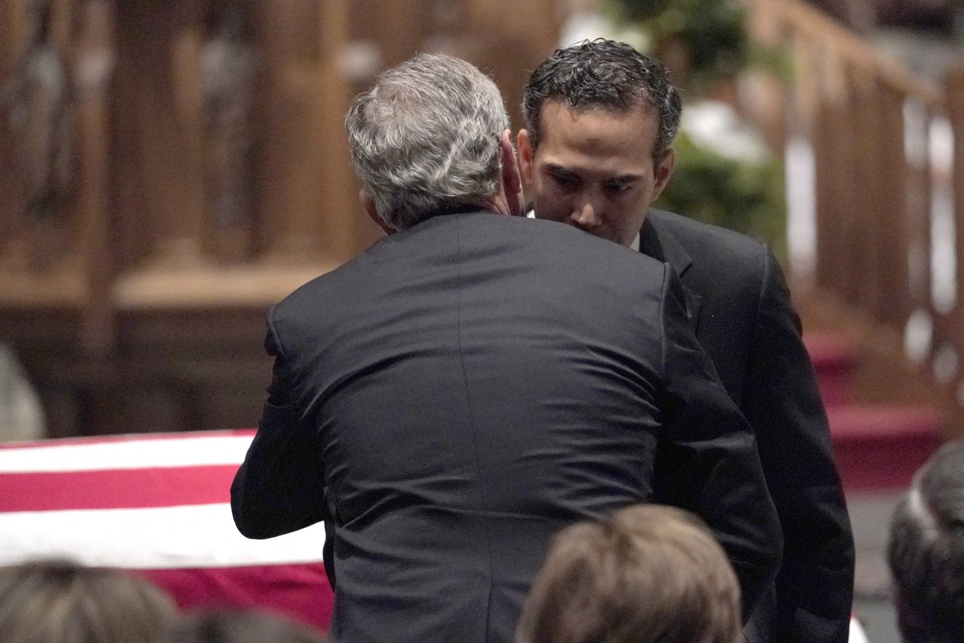 George P. Bush embraces former President George W. Bush after giving a eulogy for former President George H.W. Bush during a funeral service at St. Martin's Episcopal Church, Thursday, Dec. 6, 2018, in Houston. (AP Photo/David J. Phillip, Pool)