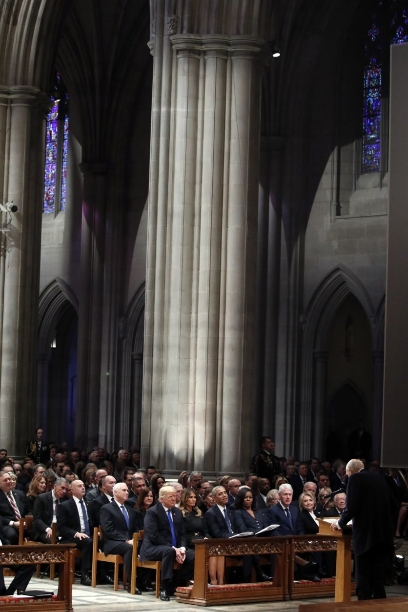 From left, President Donald Trump, first lady Melania Trump, former President Barack Obama, Michelle Obama, former President Bill Clinton, former Secretary of State Hillary Clinton, and former President Jimmy Carter listen as former Sen. Alan Simpson, R-Wyo., speaks during a State Funeral at the National Cathedral, Wednesday, Dec. 5, 2018, in Washington, for former President George H.W. Bush. In the second row are Vice President Mike Pence and Karen Pence. (AP Photo/Alex Brandon, Pool)