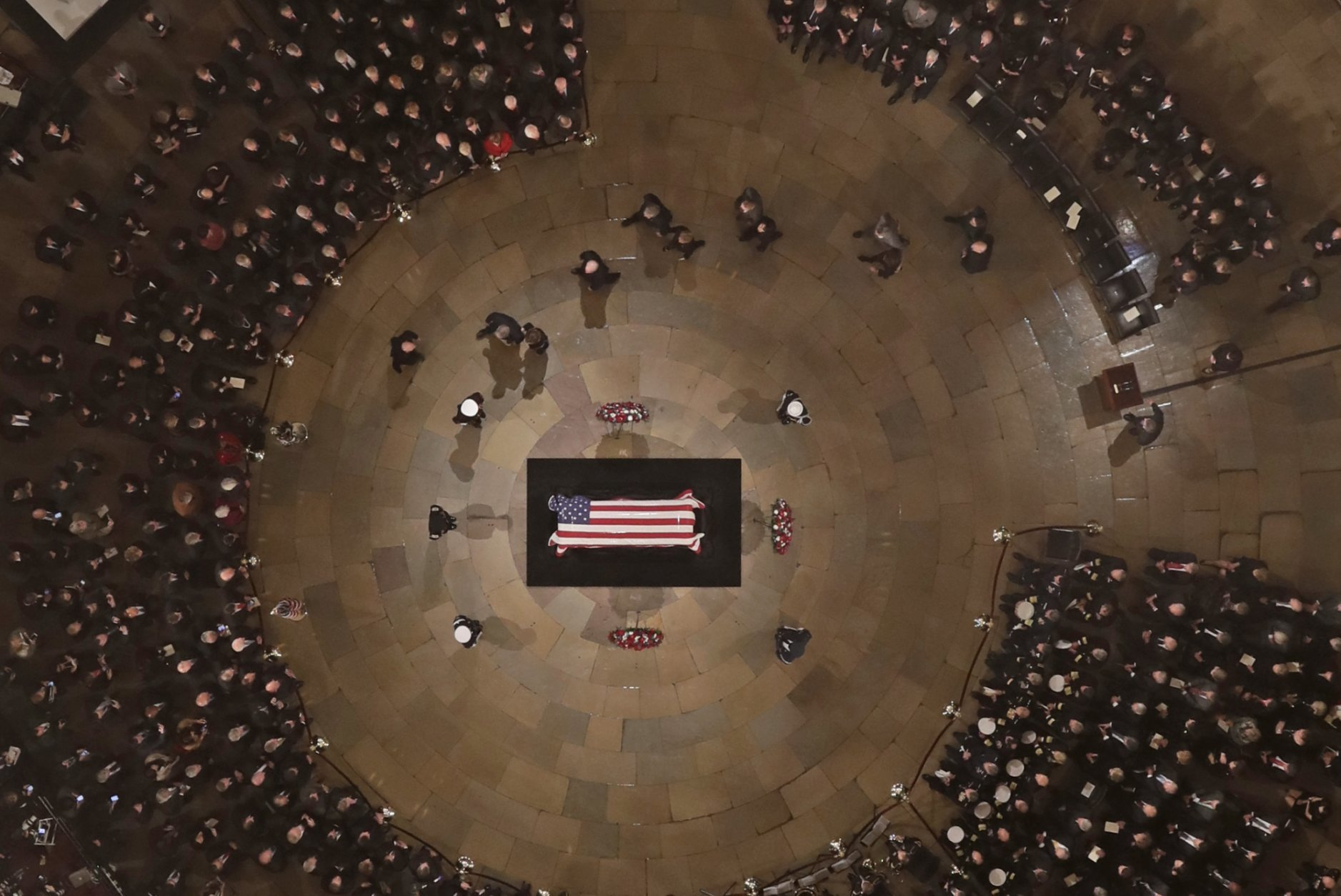Members of the Bush family walks past as former President George H. W. Bush lies in state in the U.S. Capitol Rotunda Monday, Dec. 3, 2018, in Washington. (Pool photo by Morry Gash via AP)