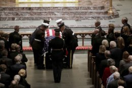 The flag-draped casket of former President George H.W. Bush is carried by a joint services military honor guard during a funeral for former President George H.W. Bush at St. Martin's Episcopal Church Thursday, Dec. 6, 2018, in Houston. (AP Photo/Mark Humphrey)