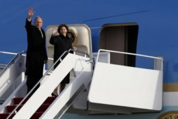 Former President George W. Bush and Laura Bush wave as they board Special Air Mission 41 to fly to Houston with the body of former President George H.W. Bush, after a State Funeral Wednesday, Dec. 5, 2018, at Andrews Air Force Base, Md. (AP Photo/Alex Brandon, Pool)