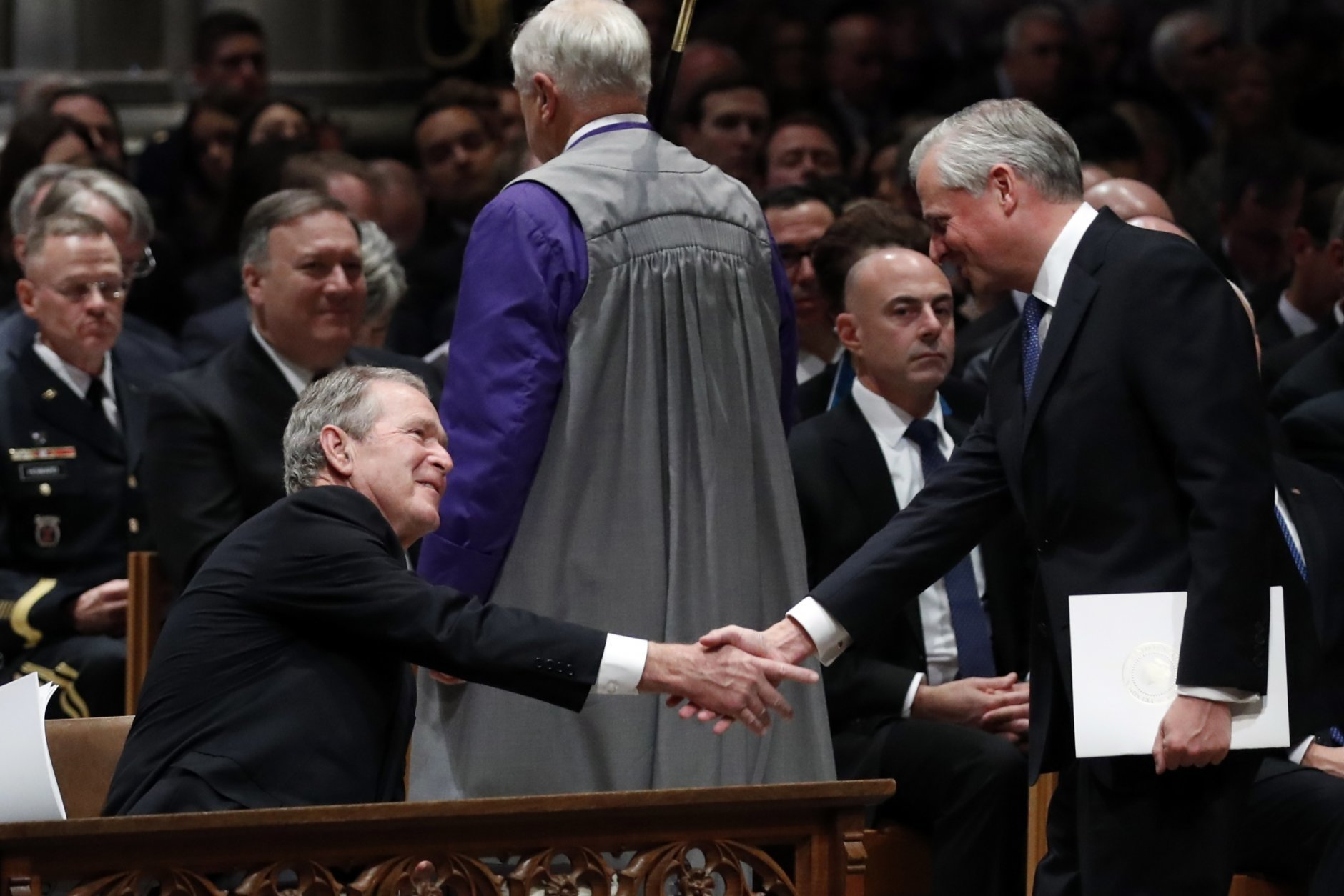 Presidential biographer Jon Meacham, shakes hands with former President George Bush after speaking during the State Funeral for former President George H.W. Bush at the National Cathedral, Wednesday, Dec. 5, 2018, in Washington.(AP Photo/Alex Brandon, Pool)