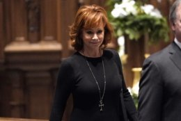 Reba McEntire arrives for a funeral service for former President George H.W. Bush at St. Martin's Episcopal Church Thursday, Dec. 6, 2018, in Houston. (AP Photo/David J. Phillip, Pool)