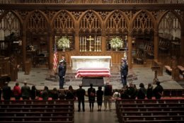 Visitors pay their respects to the flag-draped casket of former President George H.W. Bush at St. Martin's Episcopal Church, Wednesday, Dec. 5, 2018, in Houston. (AP Photo/Mark Humphrey)