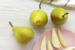 Fresh pears on white wooden background. From above, overhead view, flat lay.