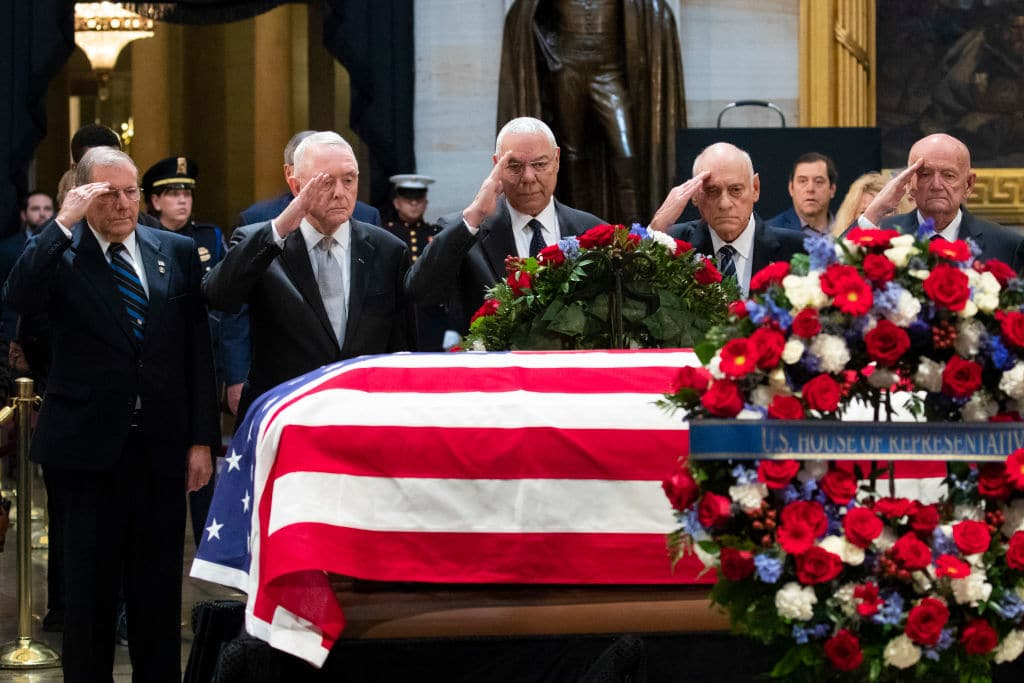 WASHINGTON, DC - DECEMBER 4:  Former Chairman of the Joint Chiefs of Staff and former Secretary of State Colin Powell (C) and former military officials from the Gulf War salute the casket of the late former President George H.W. Bush as he lies in state at the U.S. Capitol, December 4, 2018 in Washington, DC. A WWII combat veteran, Bush served as a member of Congress from Texas, ambassador to the United Nations, director of the CIA, vice president and 41st president of the United States. Bush will lie in state in the U.S. Capitol Rotunda until Wednesday morning. (Photo by Drew Angerer/Getty Images)