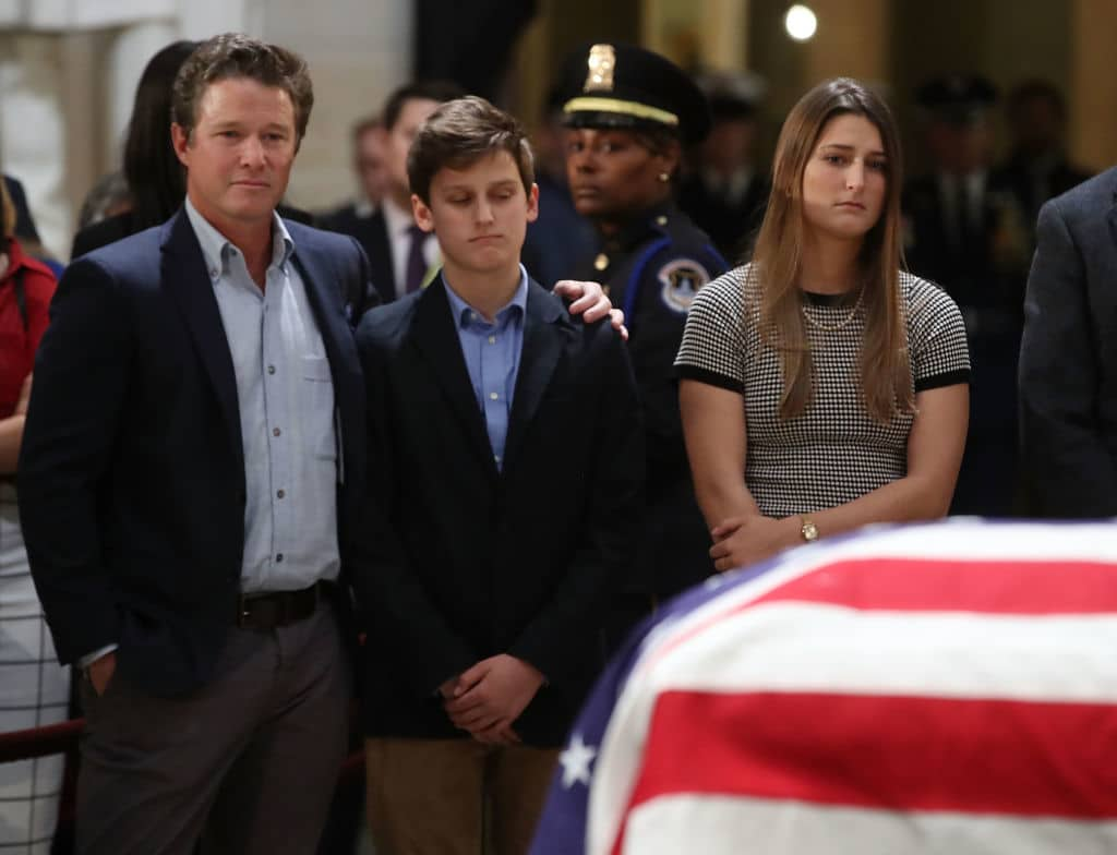 WASHINGTON, DC - DECEMBER 04: Billy Bush and Bush extended family members pay their respects in front of the casket of the late former President George H.W. Bush as he lies in state in the U.S. Capitol Rotunda, December 4, 2018 in Washington, DC. A WWII combat veteran, Bush served as a member of Congress from Texas, ambassador to the United Nations, director of the CIA, vice president and 41st president of the United States. Bush will lie in state in the U.S. Capitol Rotunda until Wednesday morning. (Photo by Mark Wilson/Getty Images)