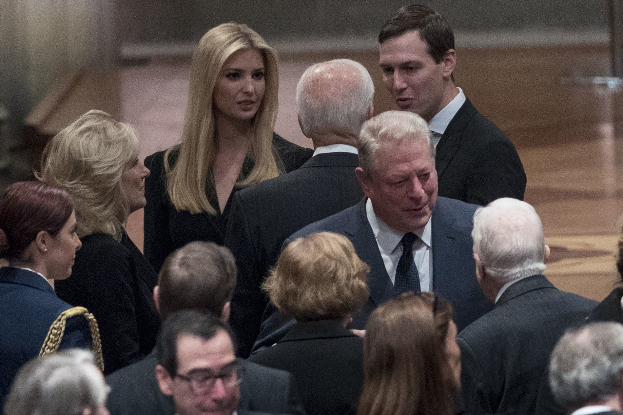 Former Vice President Joe Biden, fourth from left, and his wife Jill Biden, second from left, speak with Ivanka Trump, the daughter of President Donald Trump, third from left, and her husband, President Donald Trump's White House Senior Adviser Jared Kushner, third from right, as former Vice President Al Gore, second from right, speak to former President Jimmy Carter, right, and former first lady Rosalynn Carter, bottom center, before a State Funeral for former President George H.W. Bush at the National Cathedral, December 5, 2018 in Washington, DC. President Bush will be buried at his final resting place at the George H.W. Bush Presidential Library at Texas A&M University in College Station, Texas. A WWII combat veteran, Bush served as a member of Congress from Texas, ambassador to the United Nations, director of the CIA, vice president and 41st president of the United States. (Photo by Andrew Harnik-Pool/Getty Images)