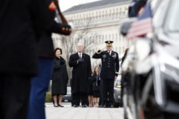 Former President George W. Bush and former first lady Laura Bush put their hands over their hearts as a joint services military honor guard carries the flag-draped casket of former U.S. President George H. W. Bush from the U.S. Capitol to transport it to Washington National Cathedral December 5, 2018 in Washington, DC. President Bush will be buried at his final resting place at the George H.W. Bush Presidential Library at Texas A&M University in College Station, Texas. A WWII combat veteran, Bush served as a member of Congress from Texas, ambassador to the United Nations, director of the CIA, vice president and 41st president of the United States.  (Photo by Alex Brandon - Pool/Getty Images)