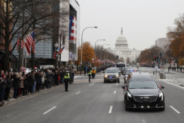 People line Pennsylvania Ave. as the hearse passes by carrying the flag-draped casket of former President George H.W. Bush as it drives away from the Capitol heading to a State Funeral at the National Cathedral on December 5, 2018 in Washington, DC. President Bush will be buried at his final resting place at the George H.W. Bush Presidential Library at Texas A&M University in College Station, Texas. A WWII combat veteran, Bush served as a member of Congress from Texas, ambassador to the United Nations, director of the CIA, vice president and 41st president of the United States.  (Photo by Alex Brandon - Pool/Getty Images)