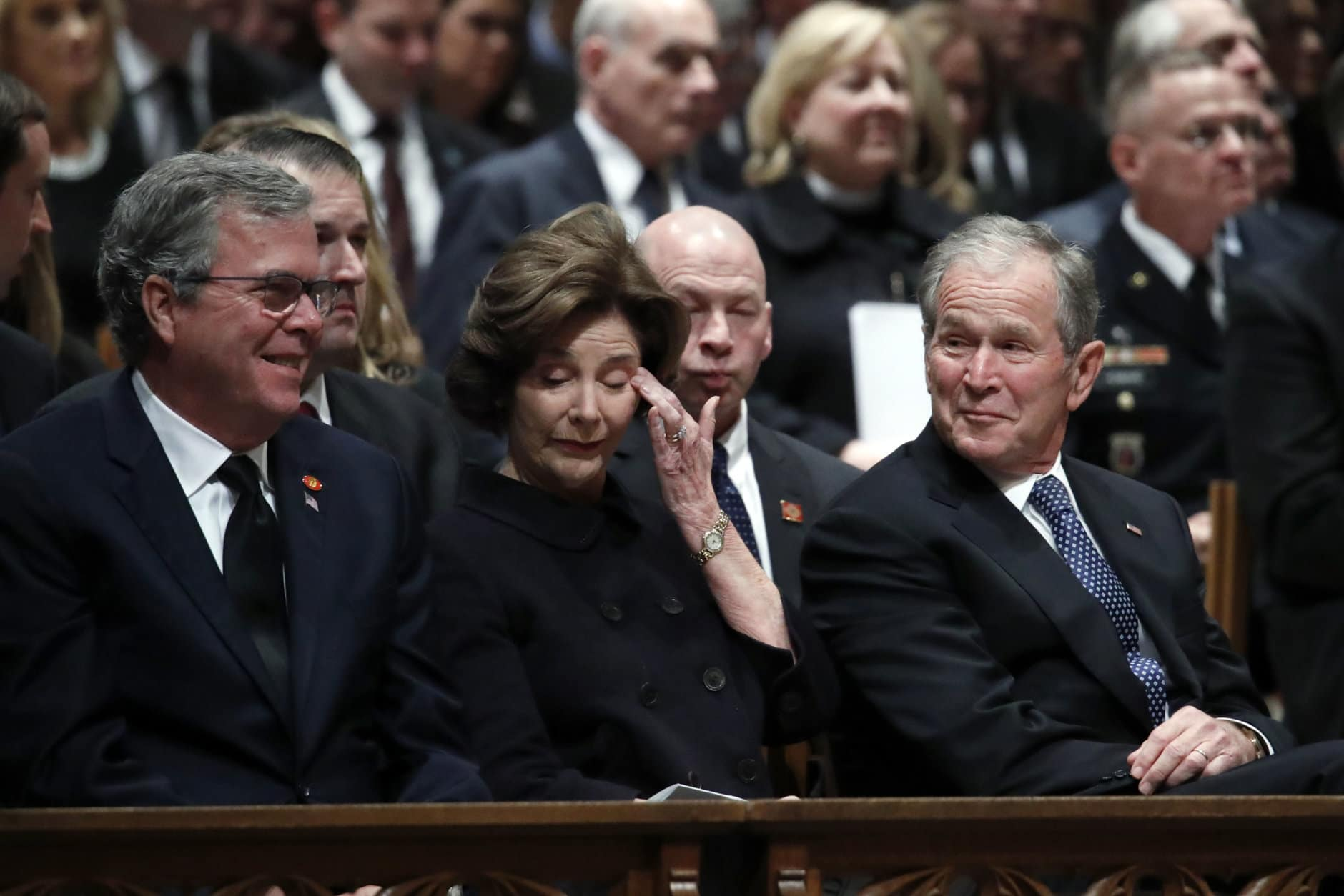 Former Florida Gov. Jeb Bush, Laura Bush and former President George W. Bush listen during a state funeral for former President George H.W. Bush at the Washington National Cathedral on December 5, 2018 in Washington, DC. President Bush will be buried at his final resting place at the George H.W. Bush Presidential Library at Texas A&M University in College Station, Texas. A WWII combat veteran, Bush served as a member of Congress from Texas, ambassador to the United Nations, director of the CIA, vice president and 41st president of the United States. (Photo by Alex Brandon - Pool/Getty Images)