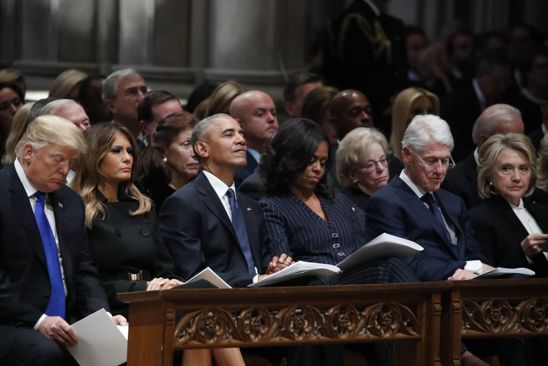 WASHINGTON, DC - DECEMBER 05: (AFP OUT) From left, President Donald Trump, first lady Melania Trump, former President Barack Obama, former first lady Michelle Obama, former President Bill Clinton and former Secretary of State Hillary Clinton listen during a state funeral for former U.S. President George H. W. Bush at the Washington National Cathedral on December 5, 2018 in Washington, DC. President Bush will be buried at his final resting place at the George H.W. Bush Presidential Library at Texas A&M University in College Station, Texas. A WWII combat veteran, Bush served as a member of Congress from Texas, ambassador to the United Nations, director of the CIA, vice president and 41st president of the United States. (Photo by Alex Brandon - Pool/Getty Images)