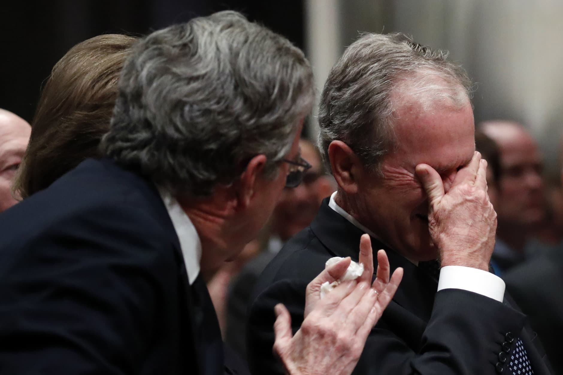 Former President George W. Bush, right, cries after speaking during the state funeral for his father, former President George H.W. Bush, at the Washington National Cathedral on December 5, 2018 in Washington, DC. President Bush will be buried at his final resting place at the George H.W. Bush Presidential Library at Texas A&M University in College Station, Texas. A WWII combat veteran, Bush served as a member of Congress from Texas, ambassador to the United Nations, director of the CIA, vice president and 41st president of the United States. (Photo by Alex Brandon - Pool/Getty Images)